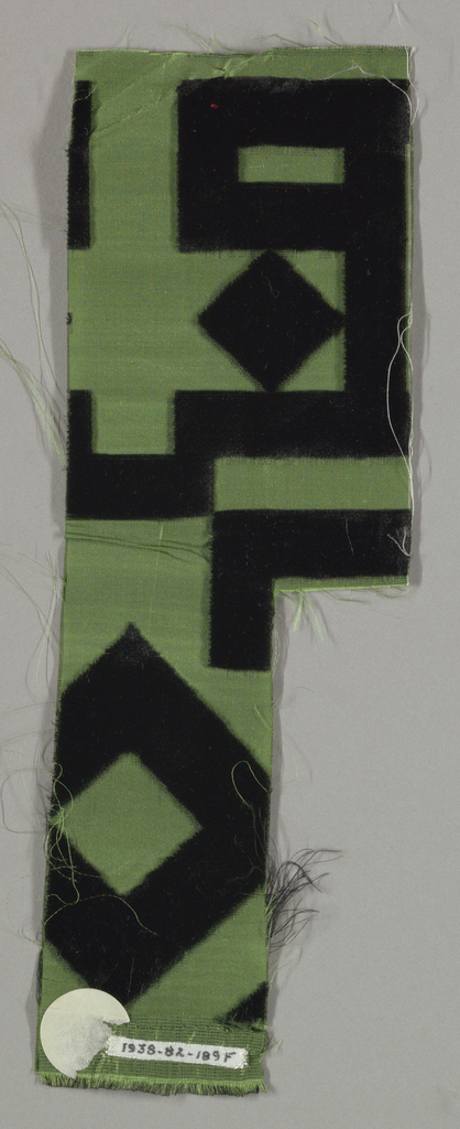 Sample of taffeta with a large-scale geometric and linear design in black cut velvet.