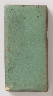 Oblong plain green tile.