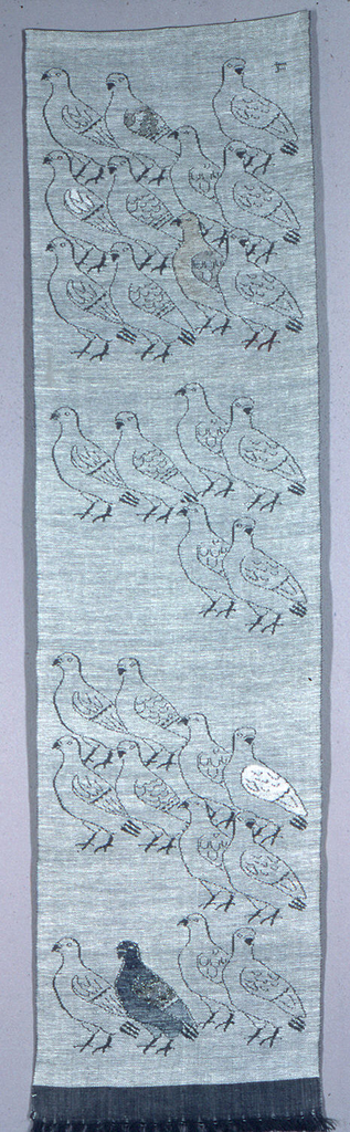 Long, narrow panel of grey/white ground with three different groups of birds. Bodies of two birds and wings and feet of others are accented by brocading in white, grey, green, brown and red. Strip of plain weave at bottom ends in warp fringe.