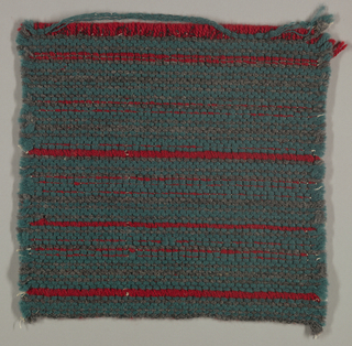 Sample of upholstery fabric: narrow red stripes created by weft on grey green created by warp.