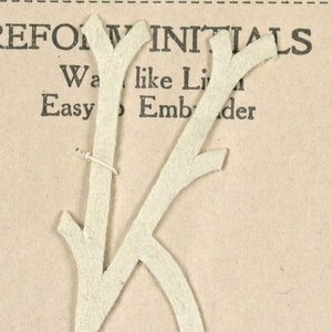 """Alphabet embroidery form, partial alphabet, """"Stick"""" letters. The letter K mounted on paper."""