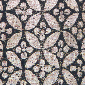 Small fragment of heavy hand-woven grayish linen block printed in black. Design a series of contiguous circular forms enclosing rosettes. Linen ground color forms most of the design with background and center of circular frame in black.