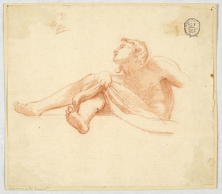 View of a man with a bare upper body, viewed from below. His right hand grasps s cloth at his knee. Only the upper pprt of his left arm is visible.