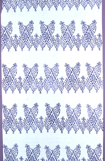 Fine white cotton printed in deep blue, with broad bands of delicate design of floriated crosses.