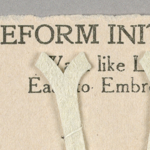 """Alphabet embroidery form, partial alphabet, """"Stick"""" letters. The letter V mounted on paper."""