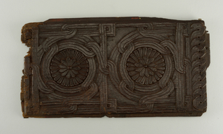 carved panel with rosettes