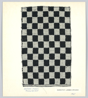 Checked patterned. Double cloth: black plain weave intercrossed with ivory float patterned plain weave. Warp ratio 1:1; weft ratio 2:2.