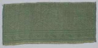 Niskhi inscription in gren on gold.