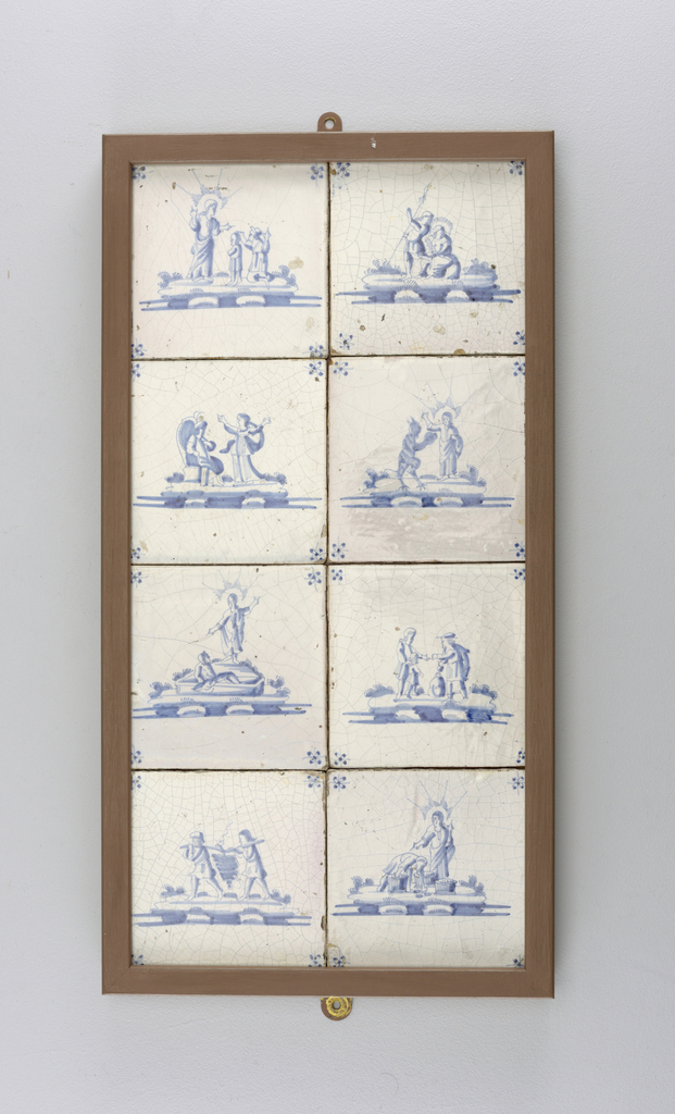 """Set of 8 square tiles, each painted in underglaze blue on white with a different Biblical scene and """"spider's head"""" corner motifs; mounted in wooden rectangular frame, 2 across, 4 down."""