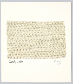 """Plain weave of string and wide """"rick-rack"""" metallic braid. Warp: white string; weft: 2 strings alternate with 1 """"rick-rack"""" braid into which synthetic metal has been braided."""