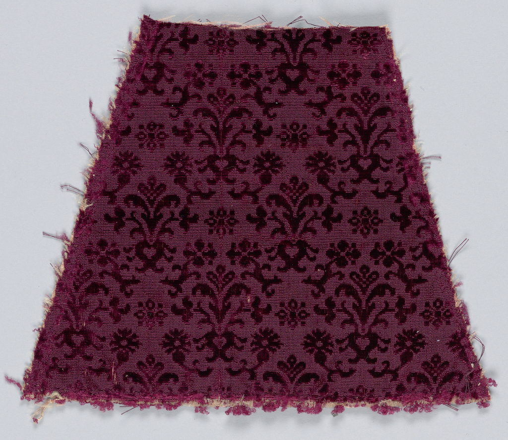 Small allover design in purple with cut pile on an uncut ground. Seventeenth century cisele-style velvet reproduction textile.