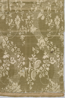 Tan silk woven with curving ribbon and floral pattern.