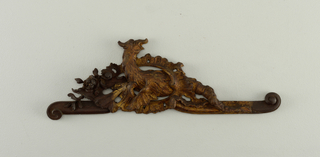 Ornament for a panel; dragon entwined in rocaille foliage and frills.