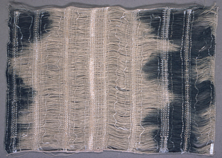 Gauze-like effect of natural linen warps occasionally held together with narrow twill-woven bands, with occasional single, eccentric wefts. The warps are hand-painted in an irregular pattern in deep indigo blue. The painted effect dominates when lit from the front, but when light shines through from the back, the structure comes forward visually.