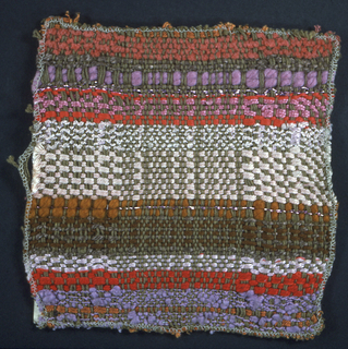 Woven plaid in shades of khaki, brown, pink, red, mauve, rust, and white.