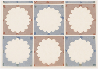 Two rows of alternating brown and blue tissue paper squares with large circular flower motifs cut from the center.