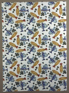 Repeating design of scattered fishes in blues, gold and rust on a white ground.