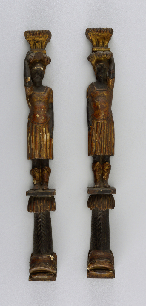Two mounts from a piece of furniture, in the form of Atlantids standing upon dolphins. Finished on only three sides.