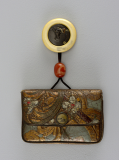 Rectangular purse of Cuir de Cordoue — Dutch leather tooled in a floral design, gilded and painted. Edges and seals bound with leather. Flap closing with a metal fastener of cooper alloy and brass, incised and inlaid flower design. Black silk chord. Kagami-buta netsuke, base ivory, plaque silver alloy with gold and copper relief inlay.