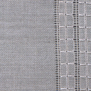 Mat with end borders patterned in cord and open work.
