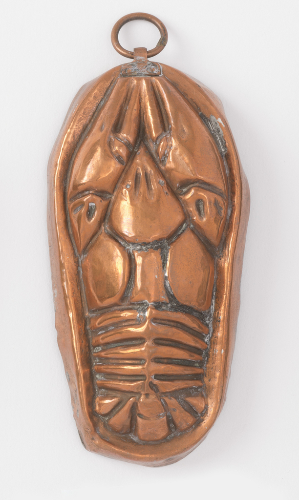 Decorated in repoussé with the figure of a lobster.