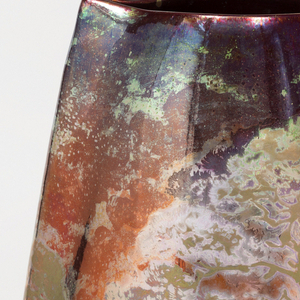 """Vase of tall ovoid section with """"pinched"""" ends, painted and glazed with iridescent copper metal oxides in a landscape with trees, water and sun"""