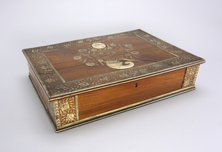 Rectangular wooden box with ivory(?) inlay decoration in center showing cornucopia with flowers and medallion; stylized foliate and floral inlaid ivory borders along edges of lid; inlaid ivory bands at edges and corners of box. Possibly for English export.