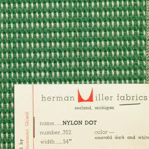 "Plain weave in green and white with every third weft doubled. Warp contains supplementary binding warps. White warp yarns create ""dot"" effect. Number 352."