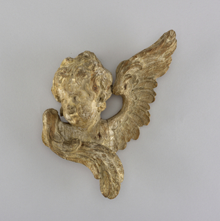 carved and gessoed, wood fragment of cherub