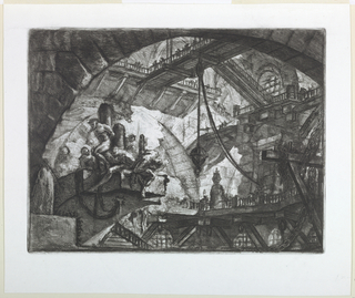 Horizontal rectangle. A broad, vaulted chamber with figures being tortured in the left foreground. Bridges connect galleries in the background. Upper right, calcografia number 358.