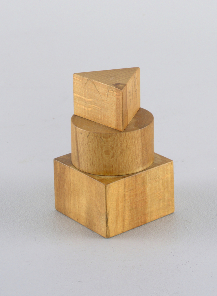 Wooden form appearing as stacked triangle, circle, square.