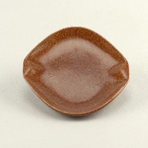 Oval form with two raised squared grips and a mottled brown glaze.