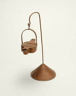 Copper betty lamp with double wicks and conical based  hanging stand.