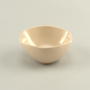 Oval form with square grip ends, beige glaze.