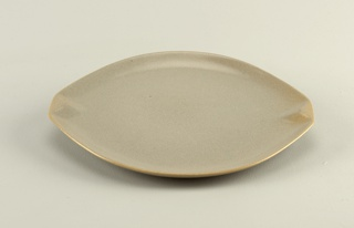 Oval with raised square grips, mottled sandy blue-grey glaze.