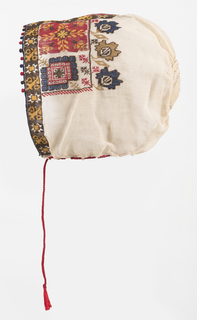 Cap of fine white voile, embroidered in multi-colored silks. Broad band across front in highly stylized plant forms, worked tightly over white thread in cross stitch. Crown crocheted in white silk in small oval. Red silk pull cord.