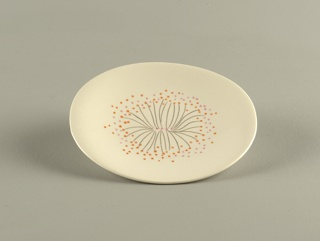 Round plate decorated with black lines, pink and orange dots on off-white ground.