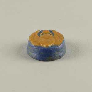 pottery in the form of a scarab, blue and ochre