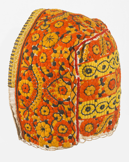 Woman's cap embroidered in characteristic design of open flowers and leaf forms. Lined in cotton.