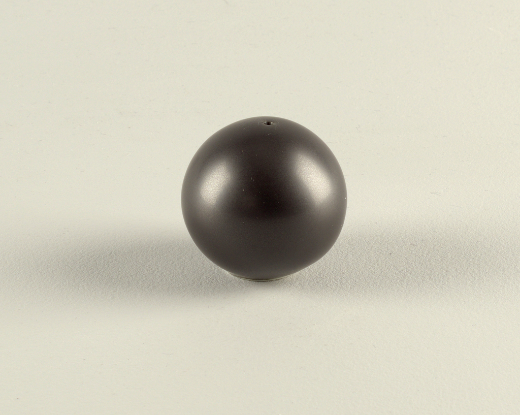 Globular form with one hole at the top.  Decorated in a matte black finish.