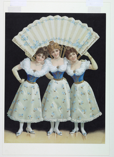 Vertical rectangle. Three young girls holding an over-size fan with forget-me-not design over their heads.