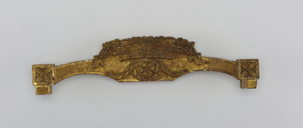 Top rail of a chair back, with portion of sides. At each end, squares with sunken rosettes. Cresting a basket of flowers, with wreath and swags of laurel below it. Back gilded, with incised design of scrolls and foliage.