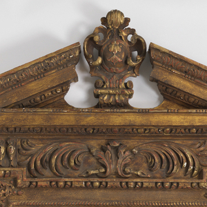 In ca. 1735 George II style. Tall, rectangular, with carved cartouche and broken-triangular pediment on top, above acanthus-decorated frieze, shaped base with putti below Vitruvian scroll banding Pair with NA 5057.