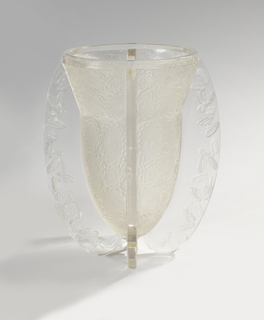 Inverted bell shape-like in frosted glass with floral pattern in low relief; four flange handles extend from the lip to the underside of the vase body at a curve; Embossed with butterfly design