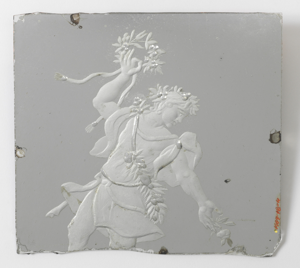 "Rectangular panel, broken in irregular edge at bottom. Decorated with figure of ""Flora"" engraved from back in dull silver heightened with mirror silver. Figure in dancing pose, wearing short tunic with garland diagonally across torso, and holding wreath in upraised right hand and flower in left."