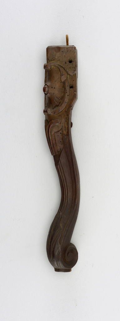 Right front leg of a chair; scroll foot, cabochon on knee. Split and repaired; shaft and foot are modern replacements.