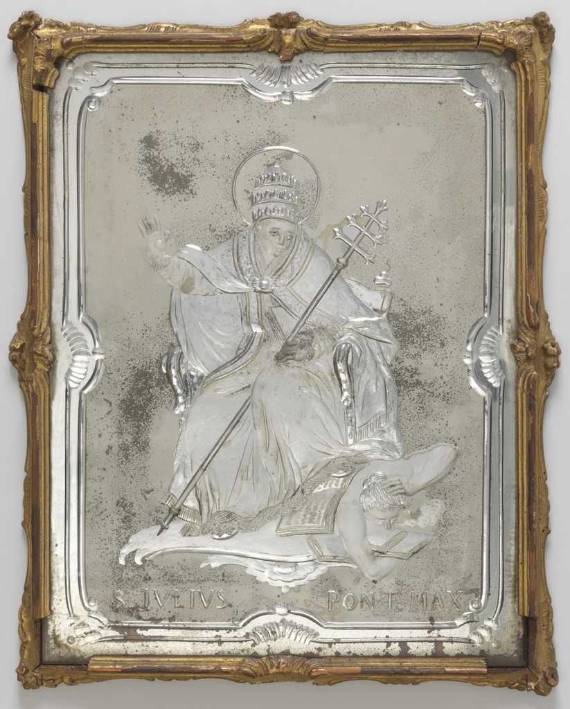 """Rectangular glass panel with shaped engraved borders on matt ground surrounding engraved subjects of Pope Julius II seated above a figure probably representing the evils overcome by his reforms; over the legend: """"S. JULIUS PONT. MAX.""""; within narrow scrolled frame of gilded wood."""