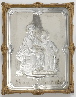 "Rectangular glass panel withshaped engraved borders on matt ground surrounding engraved subject of the youthful Virgin standing with the seated Saint Anne over the legend: ""S. ANNA MAT. M. V.""; within narrow scrolled frame of gilded wood."