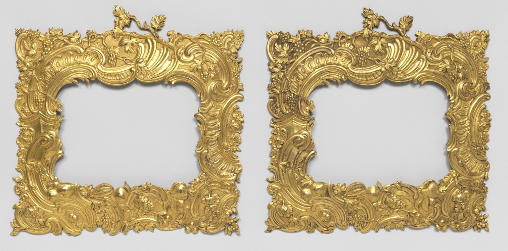 Each frame a horizontally oriented rectangle; cast decoration of rocaille scrolls ornamented with flowers and fruit.