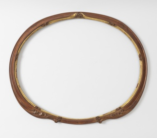 Horizontal oval natural wood frame with gilt rabbet. Molding resolving in leaves and scrolls on both sides of center top, at center bottom and four places on lower half.